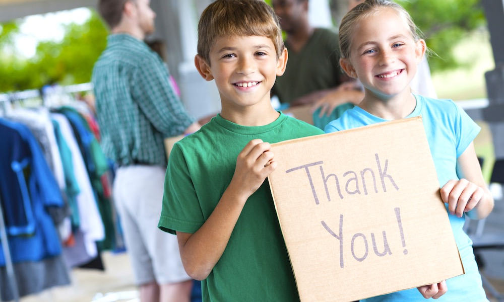 Children saying Thank You at donation center or yard sale