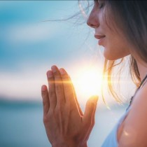 young-woman-eyes-closed-hands-in-prayer-position-768